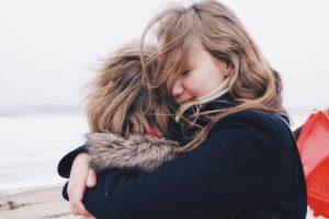 Mum hugging child