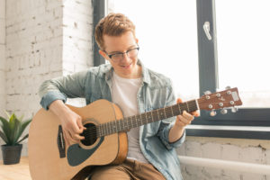 Man playing guitar for video message